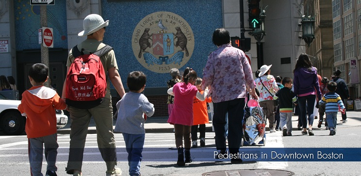 Pedestrians crossing street in Chinatown