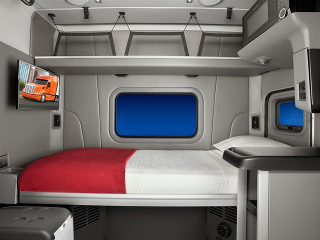 Typical sleeper cab interior with bed.